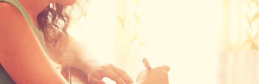 woman writing letter in sunshine